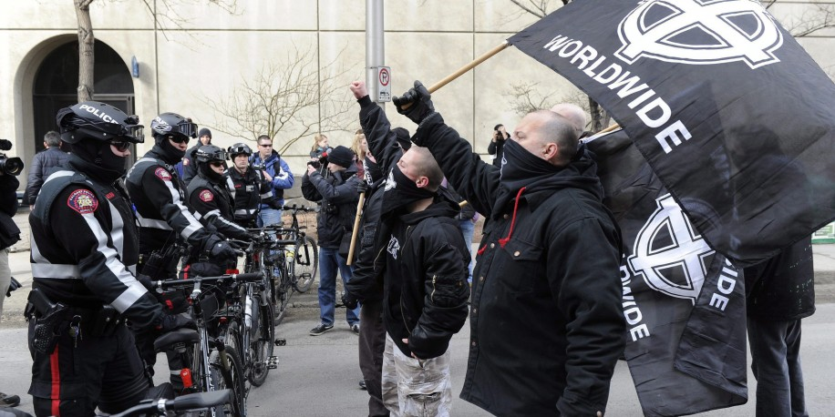 Police encounter white supremacist protesters in a 2011 rally in downtown Calgary. - Photo courtesy of The Canadian Press/Larry MacDougal