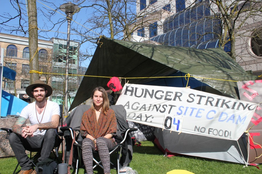 SFU alum Kristin Henry (right) sat with Sage Birley as she protested the Site C dam.