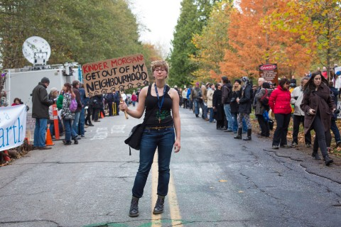 Photo of a protestor from a rally against Kinder Morgan and the oil pipeline.