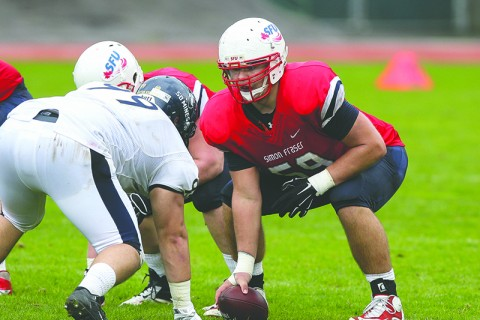 Michael Couture (right) was one of the two SFU alums selected in the CFL draft.