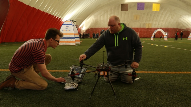 UNB students test out their drones. - Photo courtesy of CBC