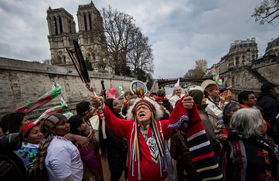 Indigenous peoples from North America protested the Paris conference on climate change last year. - Photo courtesy of The Guardian