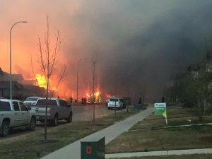 Flames engulf homes which forced a mandatory evacuation of Fort McMurray