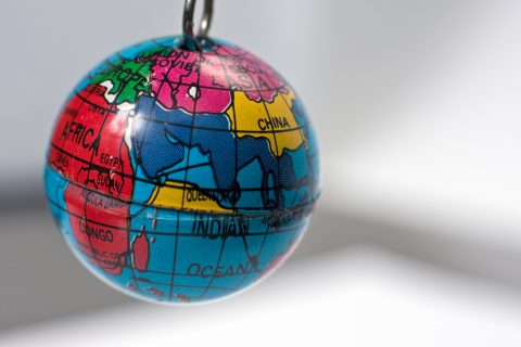 Old key chain in the shape of a small Earth globe