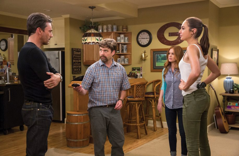 The Gaffneys (Galifianakis and Fisher, centre) put their boring lives aside to keep up with the Joneses (Hamm left, Gadot right).