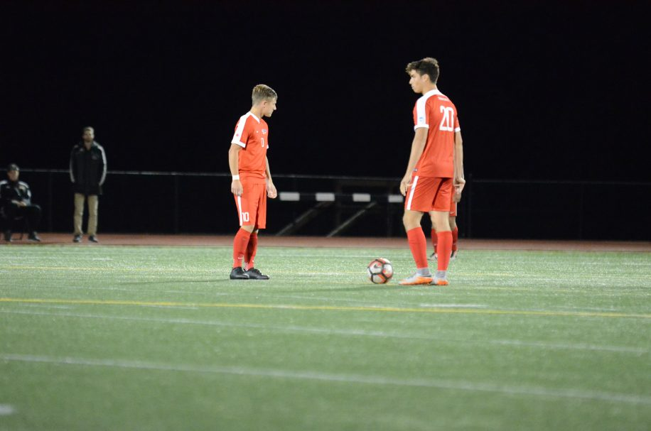 Adam Jones (left) was named GNAC Player of the Year, while Riley Pang (right) won Freshman of the Year.