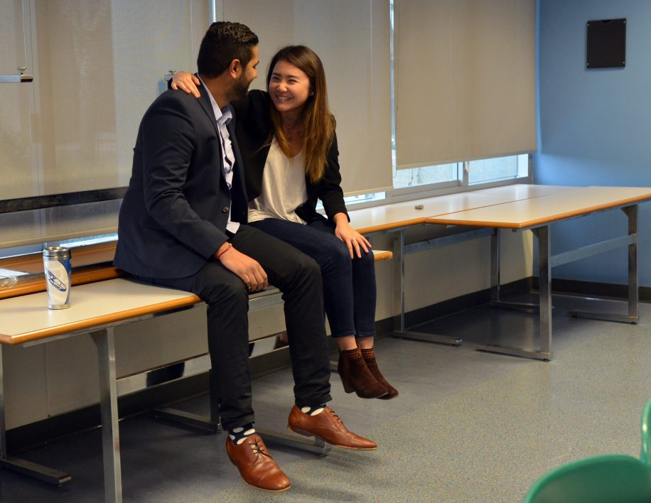 Larissa Chen (right) is congratulated by Deepak Sharma upon learning that she won the SFSS byelection.