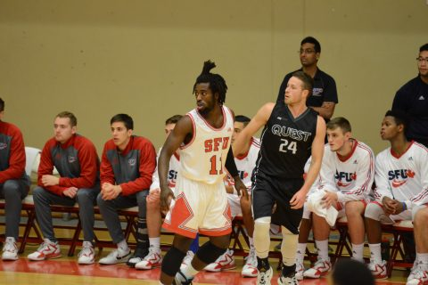 Kedar Wright (#11, seen here in action earlier this season) led SFU in scoring with 15 points.