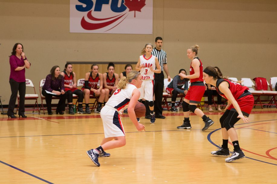 Ellen Kett (centre) had 14 points and nine assists in SFU's 12th win of the season.